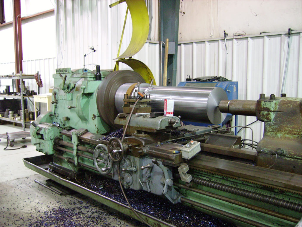 LARGE TURNING, OF SHAFT TO PRODUCE SOLID PISTON AND ROD ASSEMBLY FOR PRESS APPLICATION.
